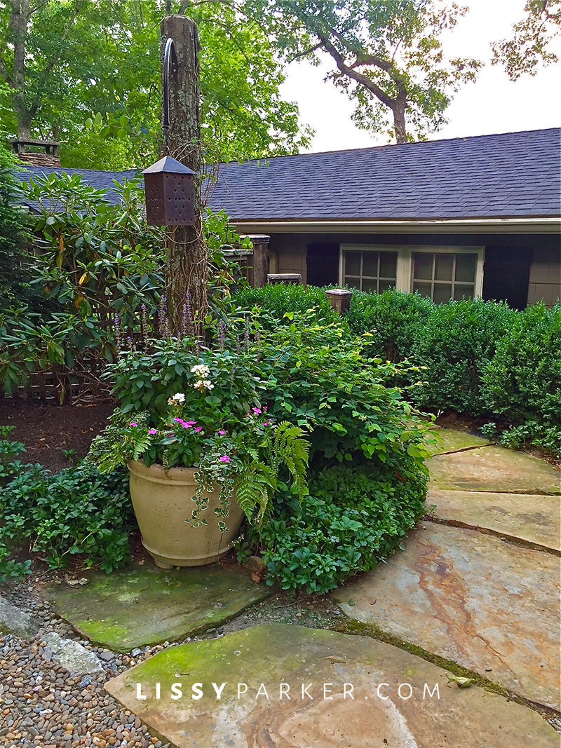 stone entry path to gray cottage home house crush